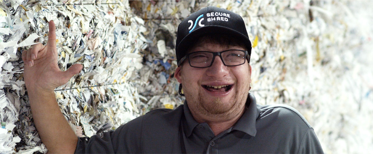 A smiling SecureShred employee