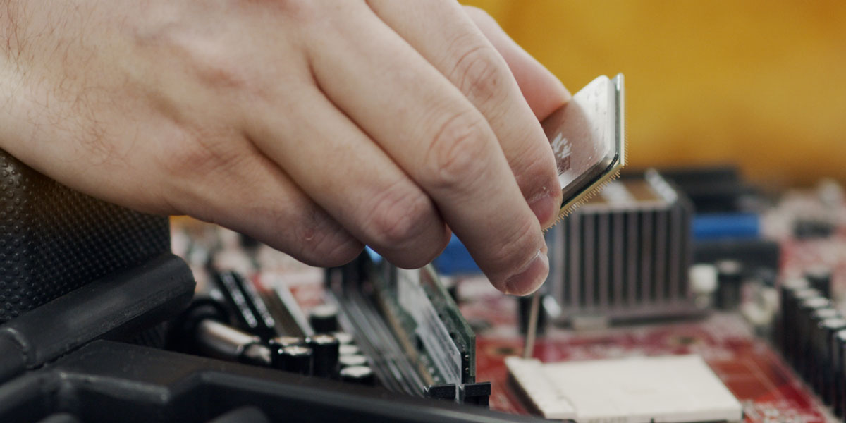 A person disassembling a computer